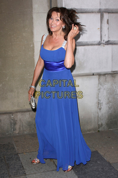 CHERIE LUNGHI .attending the Women For Women Gala, Banqueting House, London, England, UK, May 5th 2011..full length long maxi gold clutch bag beaded  sandals sleeveless  blue silver straps hand touching hair .CAP/AH.©Adam Houghton/Capital Pictures.