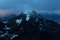 Light dusting of summer snow on summit of Stornappstind, Flakstadøy, Lofoten Islands, Norway