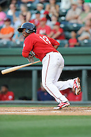 Third baseman Rafael Devers (13) of the Greenville Drive bats in a game against the Charleston RiverDogs on Saturday, May 23, 2015, at Fluor Field at the West End in Greenville, South Carolina. Devers is the No. 6 prospect of the Boston Red Sox, according to Baseball America. Charleston won 5-4. (Tom Priddy/Four Seam Images)