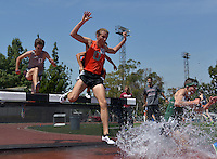 Apr 11, 2015; Los Angeles, CA, USA; Harrison Luft of Occidental College races over the water jump in the steeplechase in a SCIAC multi dual meet at Occidental College. Luft placed third in 9:50.62. Photo by Kirby Lee