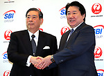 """October 3, 2017, Tokyo, Japan - Japan Airlines (JAL) president Yoshiharu Ueki (R) shakes handds with SBI Holdings president Yoshitaka Kitao as they announce to form a joint venture """"JAL SBI Fintech"""" at JAL headquarters in Tokyo on Tuesday, October 3, 2017.  JAL SBI Fintech will launch the business of multi-currency prrpaid card next year.   (Photo by Yoshio Tsunoda/AFLO) LWX -ytd-"""
