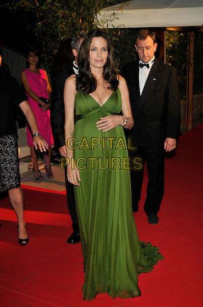 "ANGELINA JOLIE.""Kung Fu Panda"" party arrivals at the Majestic Hotel beach during the 61st Cannes International Film Festival, Cannes, France..15th May 2008 .full length maxi long green dress hand on bump belly stomach pregnant cleavage.CAP/PL.© Phil Loftus/Capital Pictures"