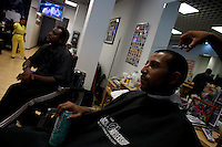 It's a busy day at Zeriff's barber shop (on left in the background ) in Hyde Park, Chicago where Senator Barack Obama, the 2008 democratic presidential candidate often has his hair cut when he is in Chicago..the Image was taken on Tuesday August 5 2008 in Chicago, Illinois, United States.