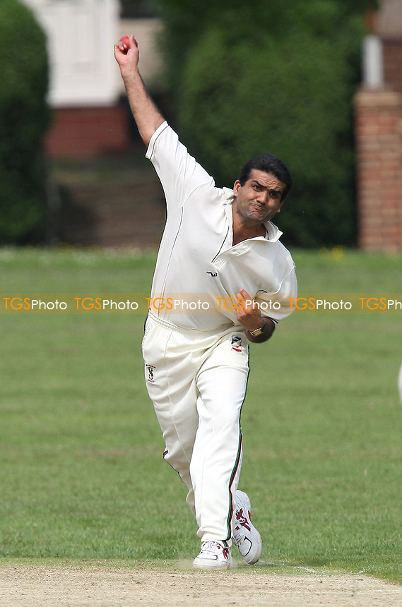 I Khan in bowling action for Ilford - Hornchurch CC vs Ilford CC - Shepherd Neame Essex Cricket League Division One at Harrow Lodge Park, Hornchurch Road, Hornchurch, Essex - 10/05/08 - MANDATORY CREDIT: Gavin Ellis/TGSPHOTO. Self-Billing applies where appropriate. NO UNPAID USE. Tel: 0845 094 6026