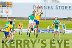 St Senans David Foran and Eoin O'Neill of Na Gaeil jump for possession in the Junior Premier football championship final on Sunday.