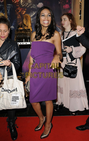 Rosario Dawson .attended the Roberto Cavalli new store launch party during London Fashion Week, Roberto Cavalli boutique, Sloane St., London, 17th September 2011..LFW full length strapless purple dress  silver shoes smiling hand clutch bag .CAP/CAN.©Can Nguyen/Capital Pictures.