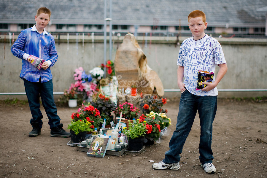 "Pictured at the Holy stump are John and James Quilligan from Limerick. Thousands of Irish Catholics have flocked to a County Limerick church to pray at the stump of a recently cut willow that many observers say has the silhouette of the Virgin Mary. The phenomenon at St Mary's parish church in Rathkeale, population 3,000 or so, harkens back to decades when Catholic devotion and pilgrimages were the dominant feature of rural life in Ireland. Some are tying the fervor for Rathkeale's ""Holy Stump"" to Ireland's stunning economic decline over the past year. When a willow tree was felled near the church entrance, a worker cut through the stump at a near-vertical angle, revealing a wooden relief that inspires some to see the Virgin Mary. Picture James Horan"