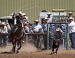 Nick Nalder competes in the calf roping event at the Minden Ranch Rodeo in Gardnerville, Nev., on Sunday, July 22, 2012..Photo by Cathleen Allison