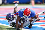 Southern Methodist Mustangs defensive back Ajee Montes (10) and TCU Horned Frogs wide receiver Kolby Listenbee (7) in action during the game between the TCU Horned Frogs and the SMU Mustangs at the Gerald J. Ford Stadium in Fort Worth, Texas. TCU defeats SMU 56 to 0.