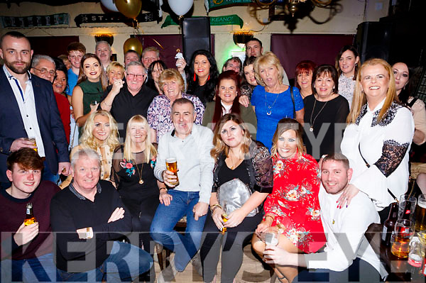 Lana O'Shea seated second from the right, celebrates a special birthday in the Greyhound Bar with her family and friends on Saturday night last.