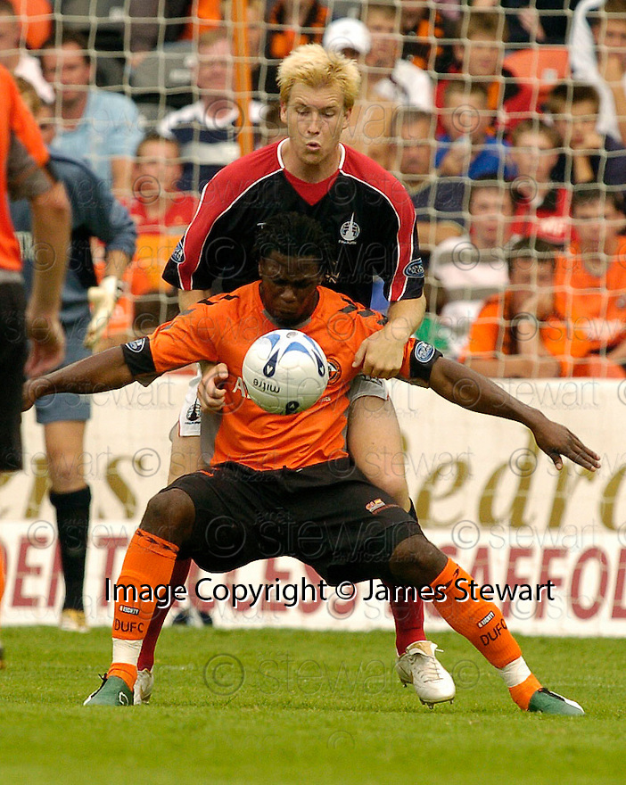 30/07/2006        Copyright Pic: James Stewart.File Name : sct_jspa23_falkirk_v_dundee_utd.DUNDEE UTD'S COLIN SMAUEL HOLDS OFF KARL DODD......Payments to :.James Stewart Photo Agency 19 Carronlea Drive, Falkirk. FK2 8DN      Vat Reg No. 607 6932 25.Office     : +44 (0)1324 570906     .Mobile   : +44 (0)7721 416997.Fax         : +44 (0)1324 570906.E-mail  :  jim@jspa.co.uk.If you require further information then contact Jim Stewart on any of the numbers above.........
