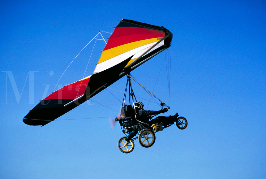 Hanglider converted into an ultralight aircraft in a clear blue sky above Cedar Valley Airport. sports, aviation Connotations - Freedom, daring, bravado. Utah, Cedar Valley.