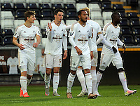 Pictured: Owain Jones of Swansea (2nd L) celebrates his goal with team mates Monday 04 April 2016<br />