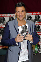 Milton Keynes, UK - Peter Andre meets fans and signs copies of his new album 'Angels & Demons' at Tesco, Milton Keynes, Bucks on October 31, 2012 ..Photo by Ross Stratton