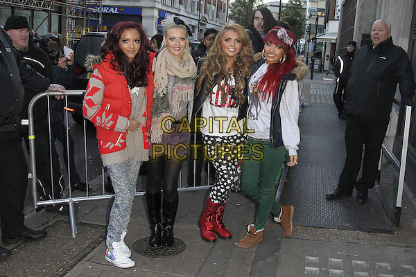 Little Mix - Leigh-Ann Pinnock, Perrie Edwards, Jesy Nelson and Jade Thirlwall.X Factor finalists at the studios of BBC Radio 1, London, England..December 5th, 2011.full length jeans denim red grey gray sleeveless puffa jacket jumper sweater white black stars print green tights.CAP/HIL.©John Hillcoat/Capital Pictures .