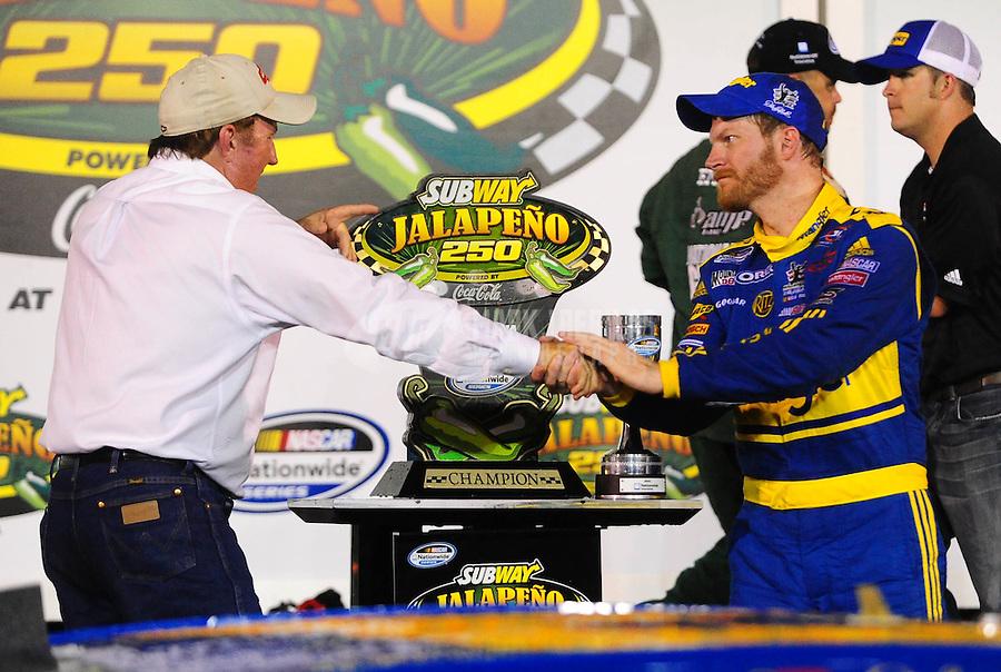 Jul. 2, 2010; Daytona Beach, FL, USA; NASCAR Nationwide Series driver Dale Earnhardt Jr (right) is congratulated by team owner Richard Childress in victory lane after winning the Subway Jalapeno 250 at Daytona International Speedway. Mandatory Credit: Mark J. Rebilas-