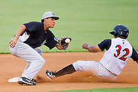 Second baseman Edwin Garcia #13 of the Hickory Crawdads waits for a throw Jordan Cheatham #32 of the Kannapolis Intimidators steals second base at Fieldcrest Cannon Stadium August 17, 2010, in Kannapolis, North Carolina.  Photo by Brian Westerholt / Four Seam Images
