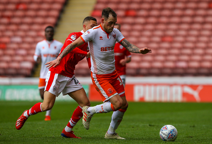 Blackpool's Harry Pritchard gets away from Barnsley's Jordan Williams<br /> <br /> Photographer Alex Dodd/CameraSport<br /> <br /> The EFL Sky Bet League One - Barnsley v Blackpool - Saturday 27th April 2019 - Oakwell - Barnsley<br /> <br /> World Copyright © 2019 CameraSport. All rights reserved. 43 Linden Ave. Countesthorpe. Leicester. England. LE8 5PG - Tel: +44 (0) 116 277 4147 - admin@camerasport.com - www.camerasport.com