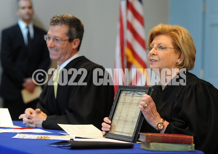 DUBLIN, PA - OCTOBER 24: Honorable Mitchell S. Goldberg (L) and Honorable Cynthia M. Rufe speak of their personal experience with naturalization of their ancestors during a Naturalization ceremony October 24, 2014 at the Pearl S. Bucks House in Dublin, Pennsylvania. 48 applicants from 28 countries were naturalized during the ceremony, and became U.S. citizens. (Photo by William Thomas Cain/Cain Images)