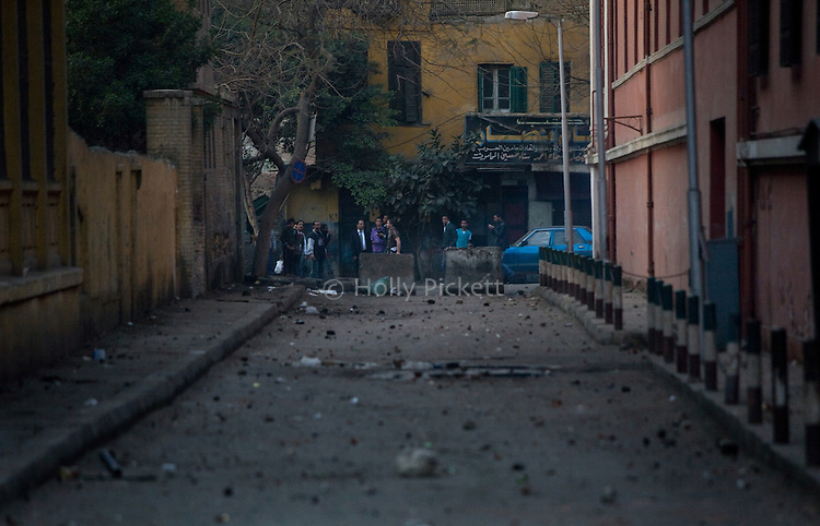 A side street is littered with rocks shortly after a clash between protesters and police in downtown Cairo, Egypt, Jan. 26, 2011. Violent clashes between demonstrators and police continued into a second day, as protesters attempted to build momentum in a movement inspired by the recent Tunisian uprising.