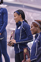 Tamara Keane and Michelle Cumberbatch on the awards stand with their 3rd and 5th place 400 meter trophies.
