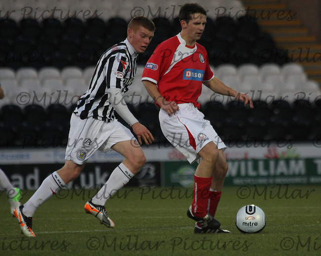 Craig Molloy is tracked by Jon Robertson in the St Mirren v Brechin City William Hill Scottish Cup Round 4 match played at St Mirren Park, Paisley on 1.12.12.