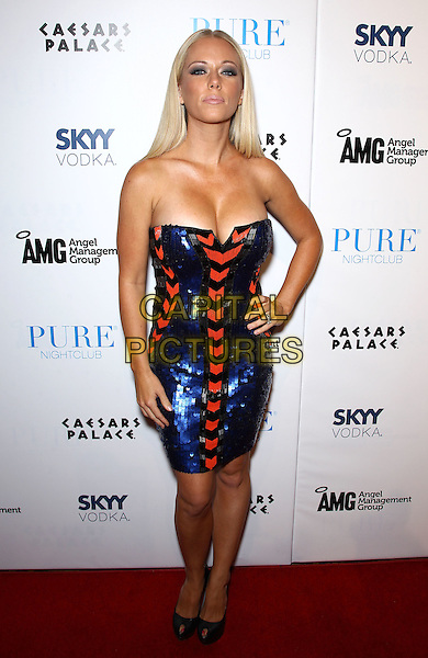 Kendra Wilkinson.Kendra Wilkinson-Baskett celebrates her birthday at Pure Night Club inside Caesars Palace, Las Vegas, Nevada, USA, 22nd June 2012..full length strapless blue red dress patterned sequined sequin  black peep toe shoes hand on hip .CAP/ADM/MJT.© MJT/AdMedia/Capital Pictures.
