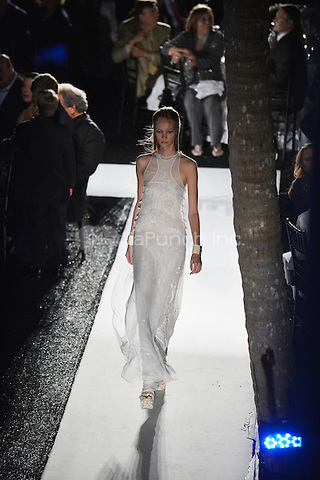 MIAMI, FL - NOVEMBER 10: A model walks the runway at Emilio Pucci's Spring 2013 Fashion Show designed by Peter Dundas presented by Saks Fifth Avenue Bal Harbour during Destination Fashion 2012 To Benefit The Buoniconti Fund To Cure Paralysis, the fundraising arm of The Miami Project to Cure Paralysis, on November 10, 2012 at Bal Harbour Shops in Miami, Florida. © MPI10/MediaPunch Inc