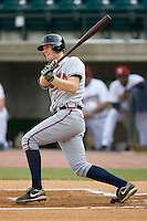 Robert Hefflinger #33 of the Danville Braves follows through on his swing versus the Greeneville Astros at Pioneer Park June 28, 2009 in Greeneville, Tennessee. (Photo by Brian Westerholt / Four Seam Images)