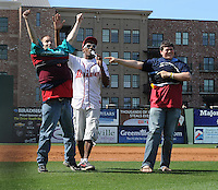 Fans of the Greenville Drive participate in a T-shirt contest during a game against the West Virginia Power on May 20, 2012, at Fluor Field at the West End in Greenville, South Carolina. Greenville won 6-5. (Tom Priddy/Four Seam Images)