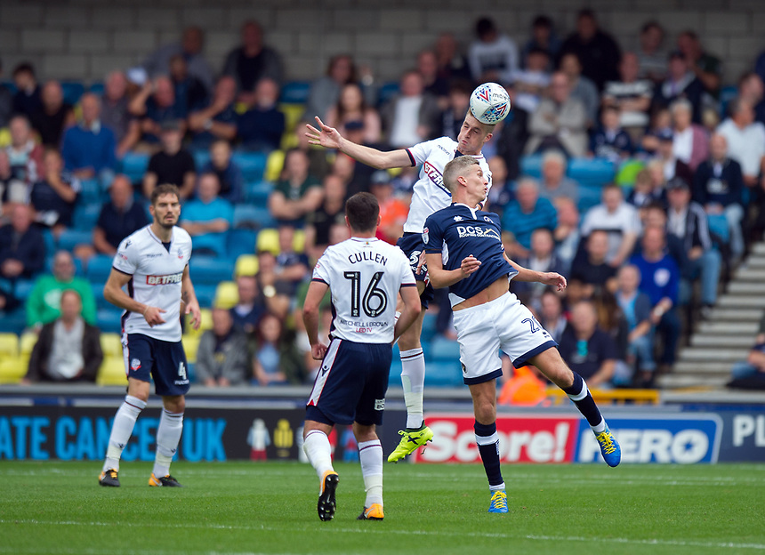 Bolton Wanderers' Mark Beevers battles for possession with Millwall's Steve Morison<br /> <br /> Photographer Ashley Western/CameraSport<br /> <br /> The EFL Sky Bet Championship - Millwall v Bolton Wanderers - Saturday August 12th 2017 - The Den - London<br /> <br /> World Copyright &not;&copy; 2017 CameraSport. All rights reserved. 43 Linden Ave. Countesthorpe. Leicester. England. LE8 5PG - Tel: +44 (0) 116 277 4147 - admin@camerasport.com - www.camerasport.com