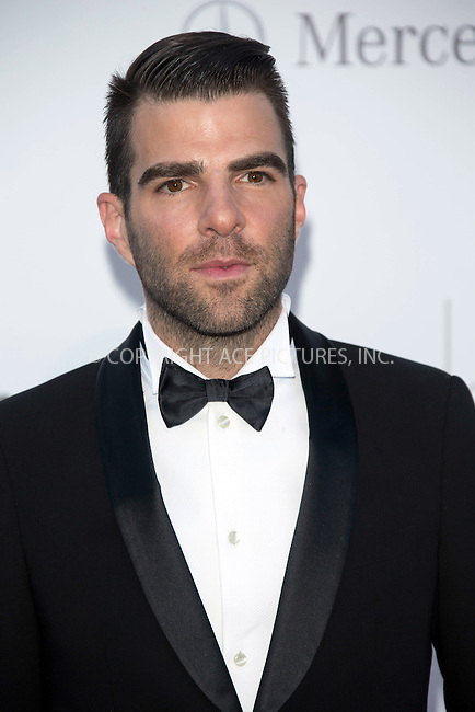 WWW.ACEPIXS.COM....US Sales Only....May 23 2013, New York City....Zachary Quinto at amfAR's Cinema Against AIDS Gala at the Hotel du Cap Eden Roc during the Cannes Film Festival on May 23 2013 in France....By Line: Famous/ACE Pictures......ACE Pictures, Inc...tel: 646 769 0430..Email: info@acepixs.com..www.acepixs.com