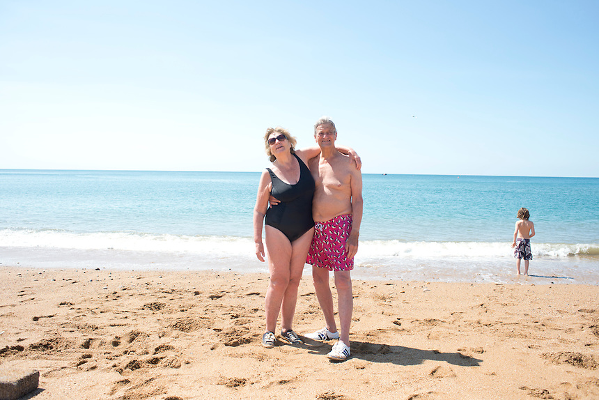My parents Sarah and John Wiseman at the beach. Summer day at West Bay, Brid Port, Dorset, UK.