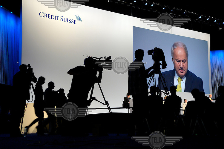 TV cameras broadcast and record the annual general meeting of Credit Suisse, as Chairman Han-Ulrich Doerig begins to respond to a shareholder who has just made a statement critical of the bank. The Swiss banking industry holds an estimated 4,000 billion Swiss Francs (USD 4,240 billion) in assets, more than half of it foreign, including CHF 880 billion in undeclared European assets alone, benefiting from the country's famous banking secrecy laws.