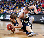 SIOUX FALLS, SD: MARCH 5: Clarissa Ober #21 from South Dakota State University battles for the loose ball with Maria Martianez #44 from Oral Roberts during the Summit League Basketball Championship on March 5, 2017 at the Denny Sanford Premier Center in Sioux Falls, SD. (Photo by Dave Eggen/Inertia)