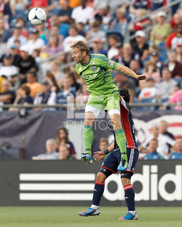Seattle Sounders FC defender Adam Johansson (5) heads the ball. In a Major League Soccer (MLS) match, the New England Revolution tied the Seattle Sounders FC, 2-2, at Gillette Stadium on June 30, 2012.