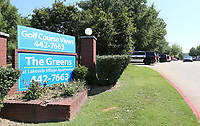 NWA Democrat-Gazette/DAVID GOTTSCHALK  The Greens Apartments are visible Friday, September 6, 2019, in Fayetteville where a man barricaded himself inside who is a suspect in a shooting Thursday night.