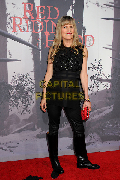 "CATHERINE HARDWICKE .""Red Riding Hood"" Los Angeles Premiere held at Grauman's Chinese Theatre,  Hollywood, California, USA, .7th March 2011..arrivals full length black sleeveless top trousers knee high boots red clutch bag .CAP/ADM/BP.©Byron Purvis/AdMedia/Capital Pictures."