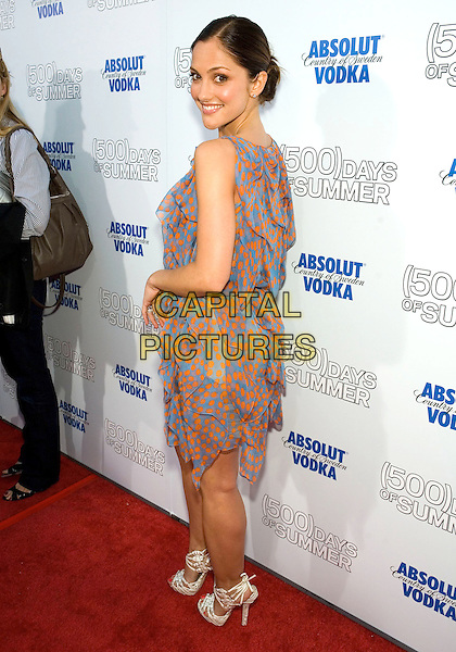 """MINKA KELLY.The Fox Searchlight L.A. Premiere of """"(500) Days of Summer"""" held at The Egyptian Theatre Theatre in Hollywood, California, USA..June 24th, 2009.full length dress white sandals pink blue orange pattern sheer polka dot looking over shoulder .CAP/ADM/TC.©T. Conrad/AdMedia/Capital Pictures."""