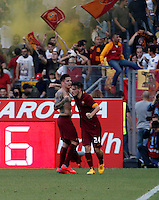 Calcio, Serie A: Lazio vs Roma. Roma, stadio Olimpico, 25 maggio 2015.<br /> Roma's Juan Iturbe, left, celebrates with teammate Alessandro Florenzi after scoring during the Italian Serie A football match between Lazio and Roma at Rome's Olympic stadium, 25 May 2015.<br /> UPDATE IMAGES PRESS/Isabella Bonotto