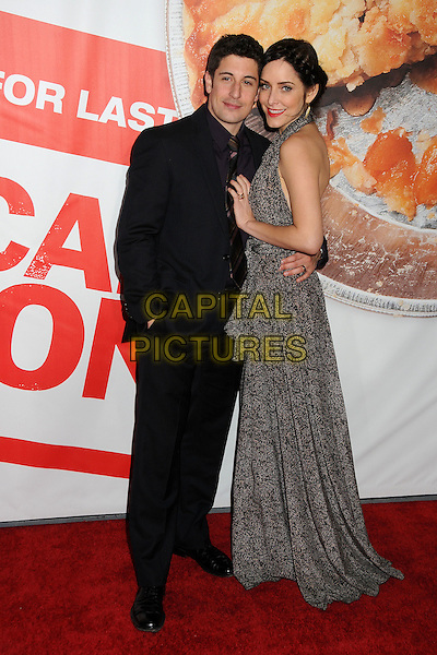 "Jason Biggs, Jenny Mollen.""American Reunion"" Los Angeles Premiere held at Grauman's Chinese Theatre, Hollywood, California, USA..19th March 2012.full length black grey gray dress halterneck print suit purple shirt married husband wife  .CAP/ADM/BP.©Byron Purvis/AdMedia/Capital Pictures."