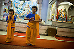 © Joel Goodman . 18 May 2013 . Gita Bhavan Hindu Temple , Withington Road , Whalley Range , Manchester . L-R Hari (four) , Sami (six)  - father is Aloke 07958 643853 wouldn't give surname but said to call if info wanted . Commemorative service to celebrate the handover of the Green Kumbh Yatra (green journey pot or environmental pilgrimage) at the Gita Bhavan Hindu Temple in Manchester . The pot has travelled to the Maha Kumbh Mela , Kenya , Nepal and the Western Wall in Jerusalem along the way . At every place of rest an environmental action must be taken to reflect the pot's environmental significance . It's due to travel to Leicester and feature in an outdoor procession in London on 24th May 2013 . Photo credit : Joel Goodman