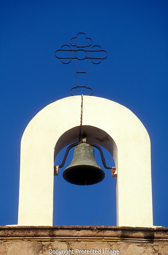 Church bell in the town of El Fuerte, Sinaloa, Mexico. The Spanish colonial town of El Fuerte is a popular stopover for tourists taking the Copper Canyon train or El Chepe.