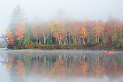 Foggy morning at Martin Meadow Pond in Lancaster, New Hampshire during the autumn months.
