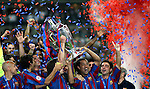 Brazilian player Ronaldinho hold hold the trophy and celebrate with Barcelona players, Xavi hernadez (right), lionel messi (left), Juliano belletti, henrik larson&amp;#xA; Spanish team Barcelona and English team Arsenal play for the Champions League Final, Wednesday May 17<br />