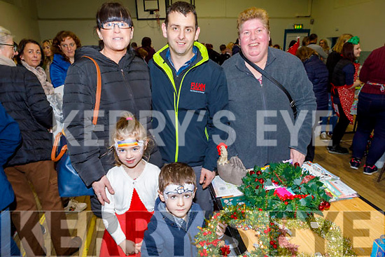 Erin, Kerry, Oisin an Dougy Roche with Bernadette O'Sullivan enjoying the Arts, Crafts and Food fare at the Ardfert Community Centre on Sunday.
