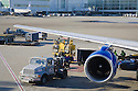 A commercial airplane being fueled by a gas truck at San Francisco International Airport. San Francisco, California, USA