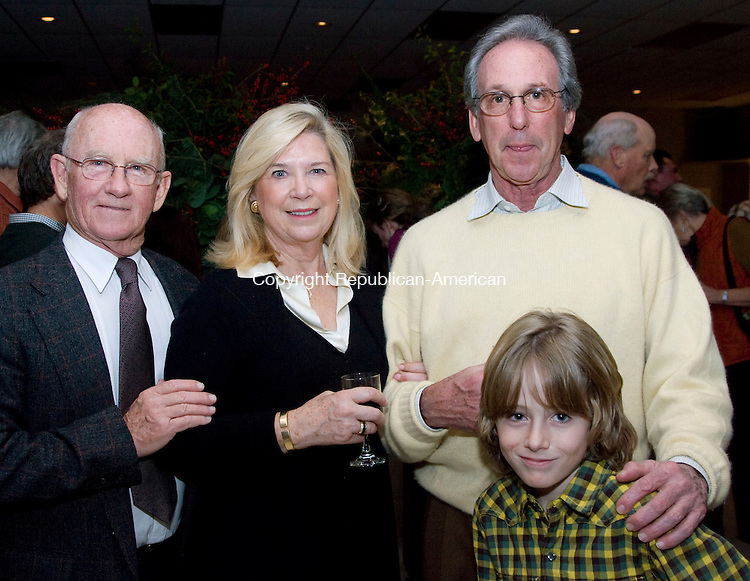 BETHLEHEM, CT - 21 NOVEMBER 2009 -112109JT10--<br /> From left, Ray Baker with Jillian Paul Kauff, Peter Kauff and Jacob Maren, 8, during the Bethlehem Land Trust's 5th annual auction, this year titled &quot;Farms, Fields and Forests&quot; on Saturday at Memorial Hall in Bethlehem.<br /> Josalee Thrift Republican-American