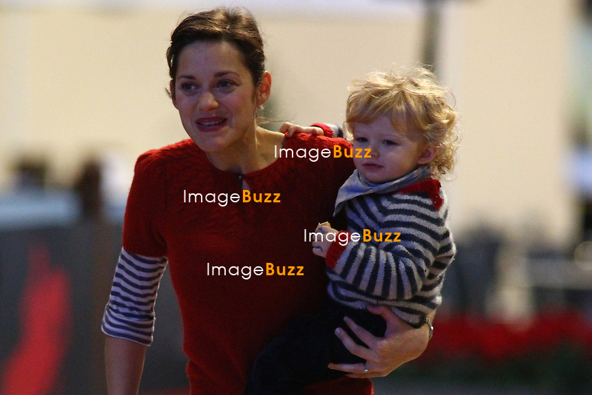 Guillaume Canet, Marion Cotillard and their son Marcel attend to the Gucci Masters show, in Paris, Friday, November 30, 2012.