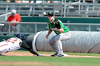 Dayton Dragons first baseman Daniel Pigott (7) takes a throw as Carlos Ramirez (32) dives back to the bag during a game against the Lansing Lugnuts on August 25, 2013 at Cooley Law School Stadium in Lansing, Michigan.  Dayton defeated Lansing 5-4 in 11 innings.  (Mike Janes/Four Seam Images)